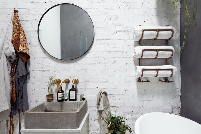 Get an Over-the-Door or Wall-Mounted Towel Rack to Save Space